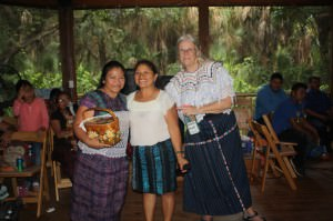 Eulalia receiving an award of excellence with Marta Matias and Dr. Genelle Grant